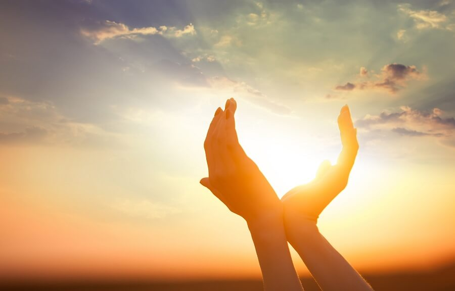 two hands pretending to hold the sun