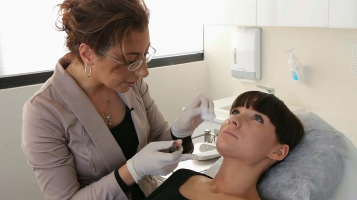 dermatologist and her patient during a treatment session