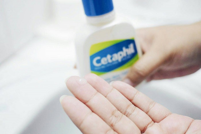 woman getting ready to use the cetaphil skin cleanser