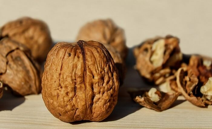 whole and half walnuts on a table