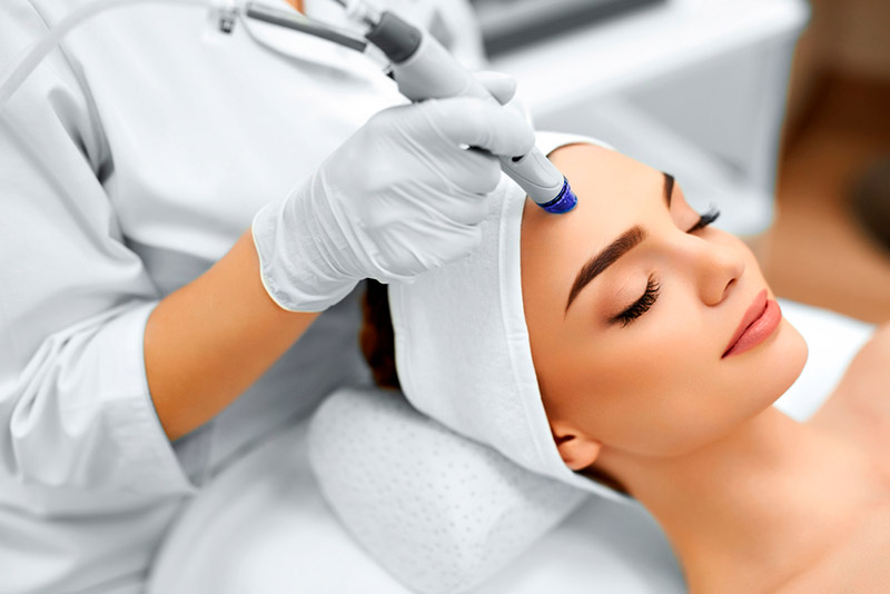 woman undergoing one of the best skin rejuvenation procedures, microdermabrasion
