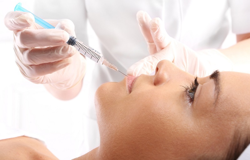woman receiving a filler injection