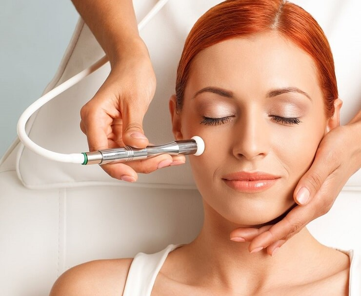 woman receiving microdermabrasion