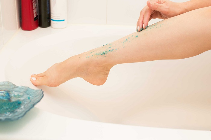 exfoliating the legs to prevent ingrown hairs