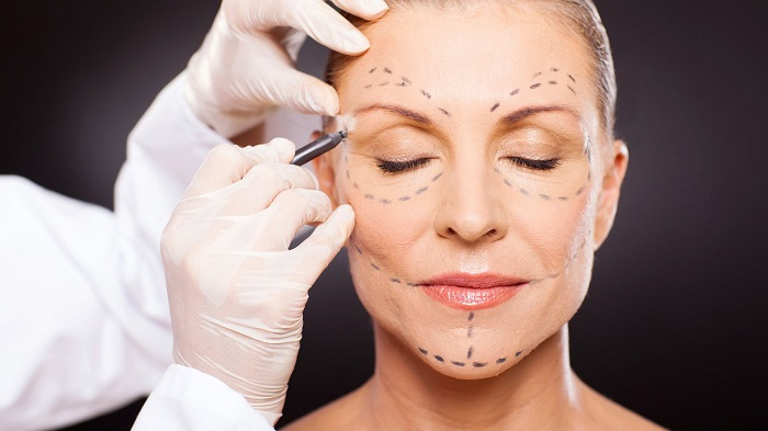 woman examined for cosmetic surgery