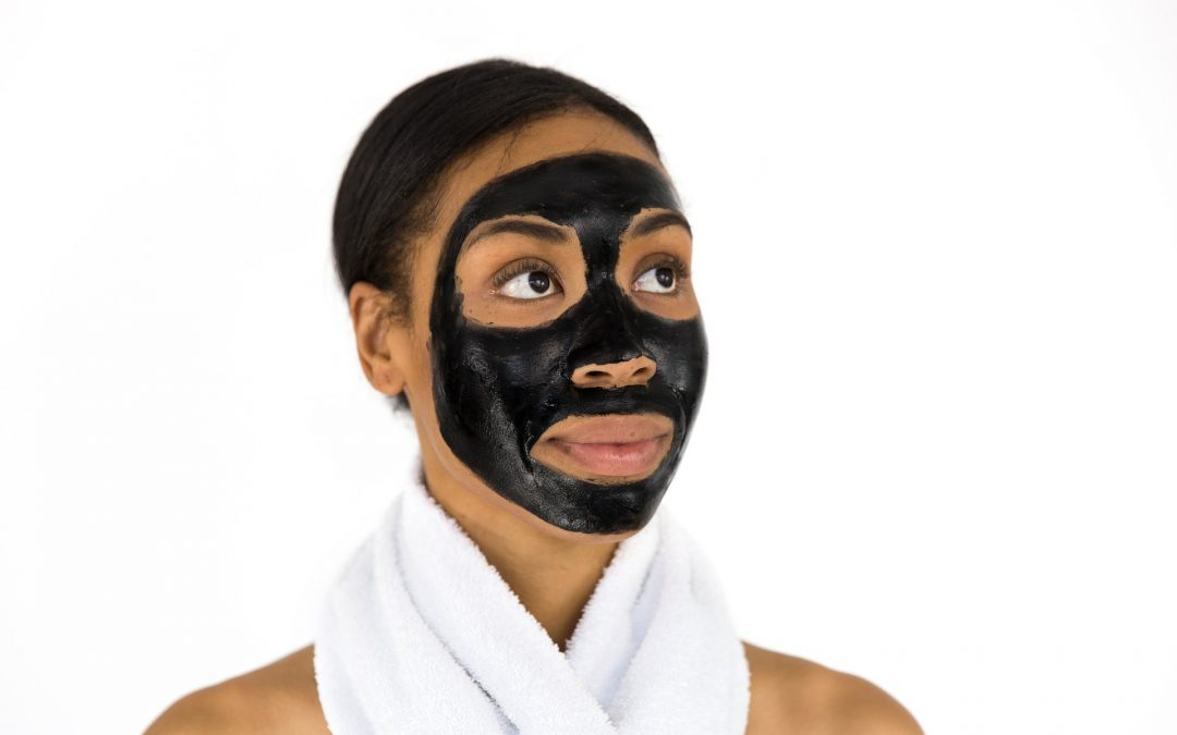 Girl with a Black Facial Mask